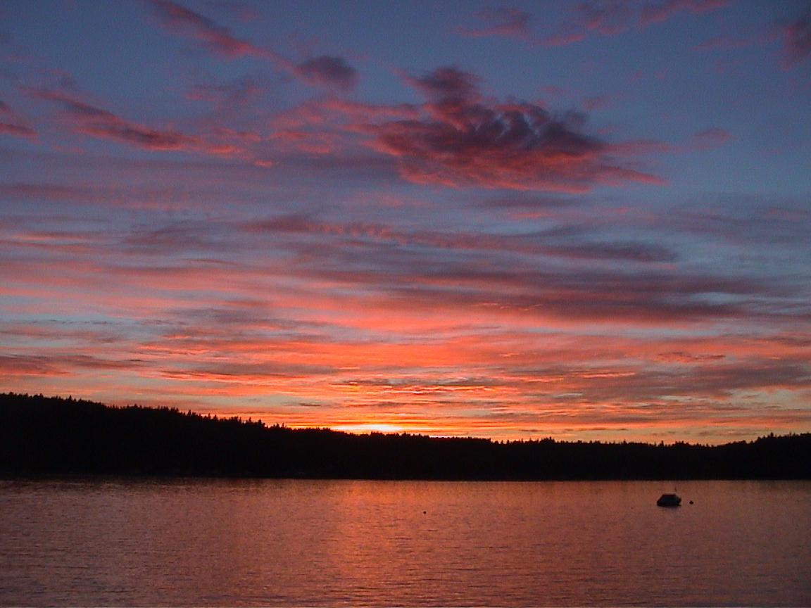 Sunset over Quartermaster Harbor, Vashon Island, Washington by R. Bornn